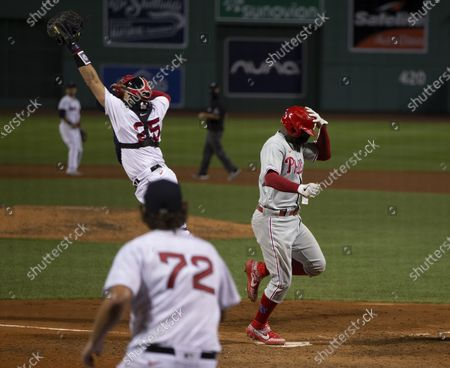 Philadelphia Phillies' Didi Gregorius (R) scores as Boston Red Sox catcher Kevin Plawecki (L) reaches for the throw while Boston Red Sox relief pitcher Josh Taylor (C) covers the plate during the sixth inning of the inter-league MLB game at Fenway Park in Boston, Massachusetts, USA, 18 August 2020.