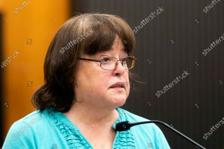 Karen Veilleux reads a statement at the podium during the first day of victim impact statements at the Gordon D. Schaber Sacramento County Courthouse in Sacramento, California, USA, 18 August 2020. DeAngelo has admitted to more than 50 rapes, including some in Santa Clara, Contra Costa and Alameda counties, but the statute of limitations expired on those crimes. DeAngelo, who admitted being the infamous Golden State Killer, listened in to the final statements of his victims and their families, before his sentencing on 18 August 2020.