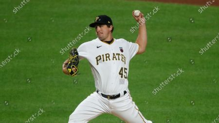 Pittsburgh Pirates relief pitcher Derek Holland delivers during a baseball game against the Cleveland Indians in Pittsburgh