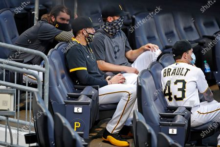 Pittsburgh Pirates starting pitchers from left Trevor Williams, Joe Musgrove, Chad Kuhl and Steven Brault (43) sit in the stands during a baseball game against the Cleveland Indians in Pittsburgh