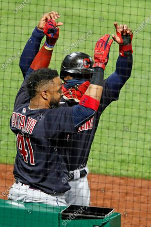 Cleveland Indians' Carlos Santana (41) celebrates with Francisco Lindor after hitting three-run home run off Pittsburgh Pirates relief pitcher Sam Howard during the 10th inning of a baseball game in Pittsburgh, . The Indians won 6-3