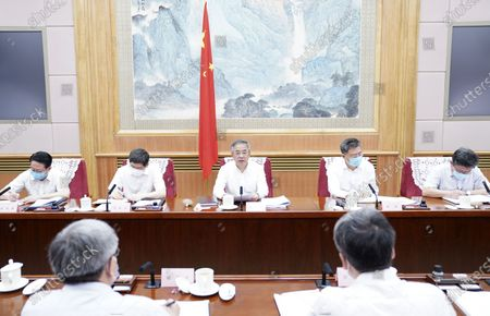 Hu Chunhua, a member of the Political Bureau of the Communist Party of China Central Committee and chief of the State Council leading group on poverty alleviation and development, presides over a meeting of the leading group in Beijing, capital of China, Aug. 18, 2020.