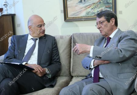 Greek Foreign Minister Nikos Dendias (L) meets with Cypriot President Nicos Anastasiades in Nicosia, Cyprus, on Aug. 18, 2020. Cyprus and Greece have agreed on joint action at the upcoming EU meetings to deal with Turkish activities in the eastern Mediterranean, which they consider to encroach on their rights, foreign ministers of the two countries said after talks here on Tuesday.