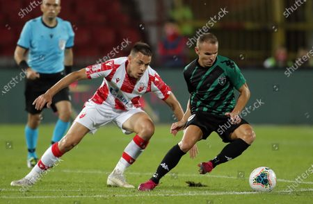 Europa's Juan Pedro Rico Dominguez (R) vies with Crvena Zvezda's Milan Rodic during UEFA Champions League first qualifying round football match between Crvena Zvezda and Europa FC in Belgrade, Serbia on Aug. 18, 2020.