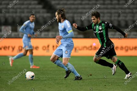 Joshua Brillante of Melbourne City on the ball as Josh Risdon of Western United closes; Jubilee Oval, Sydney, New South Wales, Australia; A League Football, Western United FC versus Melbourne City FC.