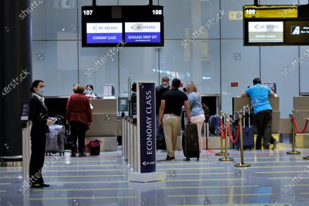 Passengers check in at Nursultan Nazarbayev International Airport in Nur-Sultan, Kazakhstan, Aug. 18, 2020. Kazakhstan has begun resuming flights to the United Arab Emirates, Belarus and Germany, among other nations, local media reported.    According to Nursultan Nazarbayev International Airport, a plane from the country's capital to the German city of Frankfurt took off on early Tuesday morning with 94 passengers on board, becoming the first direct flight between Kazakhstan and Germany since March.