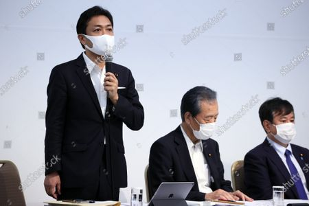 Japan's opposition Democratic Party for the People leader Yuichiro Tamaki (L) delivers a speech while Secretary General Hirofumi Hirano (C) and Diet Committee chief Kazuhiro Haraguchi (R) look on at the oepning of the party's lawmakers meeting in Tokyo on Wednesday, August 19, 2020. Democratic Party for the People and another opposition Constitutional Democratic Party of Japan have talks to merge their parties.