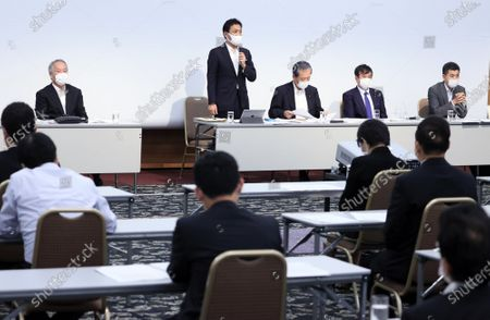 Japan's opposition Democratic Party for the People leader Yuichiro Tamaki (C) delivers a speech at the oepning of the party's lawmakers meeting in Tokyo on Wednesday, August 19, 2020. Democratic Party for the People and another opposition Constitutional Democratic Party of Japan have talks to merge their parties.