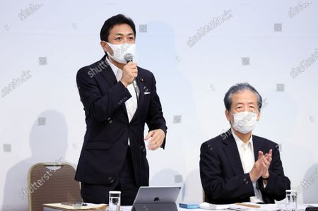 Japan's opposition Democratic Party for the People leader Yuichiro Tamaki (L) delivers a speech while Secretary General Hirofumi Hirano (R) looks on at the oepning of the party's lawmakers meeting in Tokyo on Wednesday, August 19, 2020. Democratic Party for the People and another opposition Constitutional Democratic Party of Japan have talks to merge their parties.