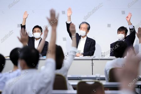 Stock Photo of Japan's opposition Democratic Party for the People leader Yuichiro Tamaki (L), Secretary General Hirofumi Hirano (C) and Diet Committee chief Kazuhiro Haraguchi (R) and party members raise their hands for a vote at the party's lawmakers meeting in Tokyo on Wednesday, August 19, 2020. Democratic Party for the People decided to merge  with another opposition Constitutional Democratic Party of Japan but Tamaki will not join the new party.