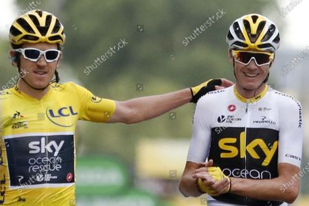 Tour de France winner Britain's Geraint Thomas, wearing the overall leader's yellow jersey, and Britain's Chris Froome, right, cross the finish line of the twenty-first stage of the Tour de France cycling race over 116 kilometers (72.1 miles) with start in Houilles and finish on Champs-Elysees avenue in Paris. Former Tour de France champions Chris Froome and Geraint Thomas were both left off the INEOS team for this year's race. INEOS announced its selections for the pandemic-affected season with its top riders allocated to each of the three major stage races