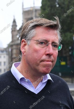 Stock Image of Graham Brady, Chairman of the 1922 committee, outside the Houses of Parliament.