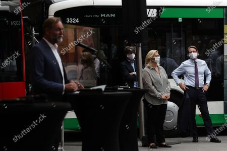 Anke Rehlinger, Minister of Transport of the Saarland, (C) and German Minister of Transport Andreas Scheuer (R) attend a press conference for a campaign '#BetterFurther (#BetterWeiter)' to promote public transport after corona pandemic lockdown in Berlin, Germany, 19 August 2020. Transport companies with the federal government and municipalities intensify their commitment in order to normalise the use of public transportation.
