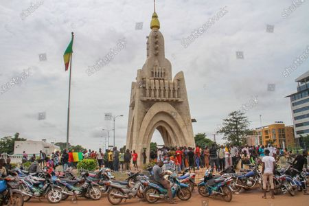 People gather at Place de l'Independence in Mali's capital Bamako, one day after President Ibrahim Boubacar Keita was forced to resign in a military coup. Members of the international community already have strongly condemned Tuesday's events and have called for constitutional order to be restored