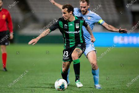 Western United midfielder Alessandro Diamanti (23) holds the ball under pressure from Melbourne City midfielder Rostyn Griffiths (7)