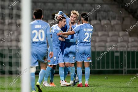 Melbourne City forward Jamie Maclaren (9) celebrates his goal with team mates
