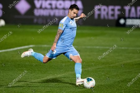 Melbourne City forward Jamie Maclaren (9) scores from the penalty spot