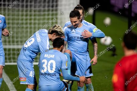 Melbourne City forward Jamie Maclaren (9) scores from the penalty spot and celebrates