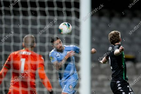 Melbourne City forward Jamie Maclaren (9) heads the ball