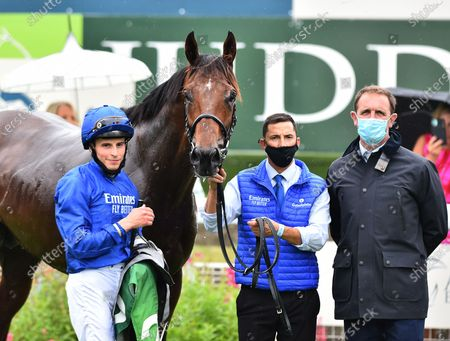 Stock Photo of (L) William Buick, jockey of Ghaiyyath, with trainer Charlie Appleby , after winning The Juddmonte International Stakes. Photo © Hugh Routledge.