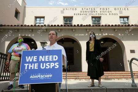 Rep. Adam Schiff, D-Burbank, center, flanked by a retired later carrier Darcel Cole, left, and assembly member Laura Friedman, addresses a news conference to highlighting how cuts in service instituted by Postmaster General Louis DeJoy ``are significantly delaying mail delivery and negatively impacting constituents, including veterans and local small business owners.'' Bob Hope Post Office on Tuesday, Aug. 18, 2020 in Burbank, CA. (Irfan Khan / Los Angeles Times)