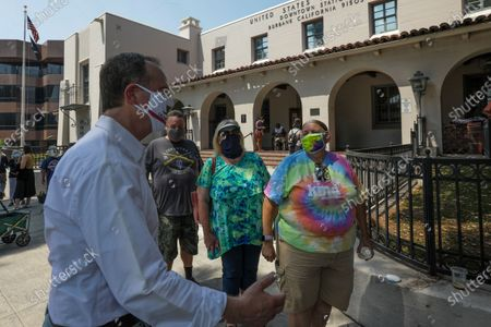 Rep. Adam Schiff, D-Burbank, left, chats with a retired later carrier Darcel Cole, right, and others after a news conference held Bop Hope post Office on Tuesday, Aug. 18, 2020 in Burbank, CA. (Irfan Khan / Los Angeles Times)