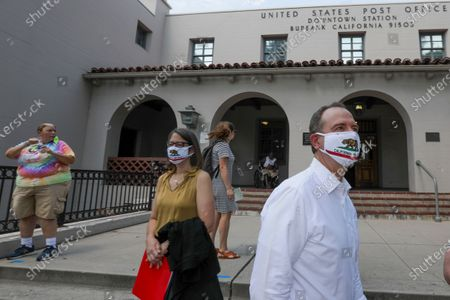 A retired later carrier Darcel Cole, left, assembly member Laur a Friedman and Rep. Adam Schiff, D-Burbank,, after a news conference held at Bob Hope Post Office oon Tuesday, Aug. 18, 2020 in Burbank, CA. (Irfan Khan / Los Angeles Times)