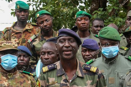 Colonel-Major Ismael Wague, centre, spokesman for the soldiers identifying themselves as National Committee for the Salvation of the People, speaks during a press conference at Camp Soudiata in Kati, Mali, one day after President Ibrahim Boubacar Keita was forced to resign in a military coup. The military takeover was swiftly condemned by the international community, despite promesses of new elections