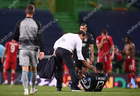 Olympique Lyon's head coach Rudi Garcia comforts Thiago Mendes (down) of Lyon after losing the  UEFA Champions League semi final match between Olympique Lyon and Bayern Munich in Lisbon, Portugal, 19 August 2020.