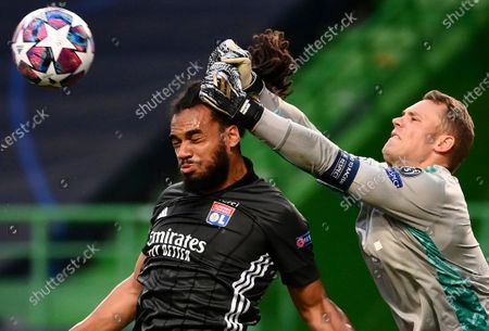 Bayern's goalkeeper Manuel Neuer, right, makes a save in front of Lyon's Jason Denayer during the Champions League semifinal soccer match between Lyon and Bayern at the Jose Alvalade stadium in Lisbon, Portugal