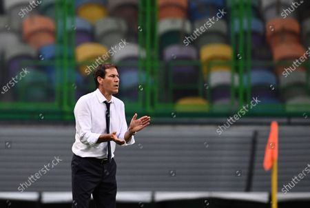 Lyon's head coach Rudi Garcia reacts during the Champions League semifinal soccer match between Lyon and Bayern at the Jose Alvalade stadium in Lisbon, Portugal