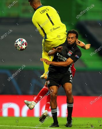 Olympique Lyon's goalkeeper Anthony Lopes (L) and Jason Denayer (R) in action during the UEFA Champions League semi final soccer match between Olympique Lyon and Bayern Munich in Lisbon, Portugal, 19 August 2020.