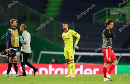 Olympique Lyon's goalkeeper Anthony Lopes (C) reacts after the UEFA Champions League semi final soccer match between Olympique Lyon and Bayern Munich in Lisbon, Portugal, 19 August 2020.