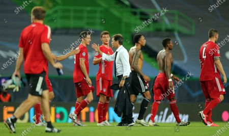 Olympique Lyon's head coach Rudi Garcia (C) shakes hands with Bayern Munich players after the UEFA Champions League semi final soccer match between Olympique Lyon and Bayern Munich in Lisbon, Portugal, 19 August 2020.