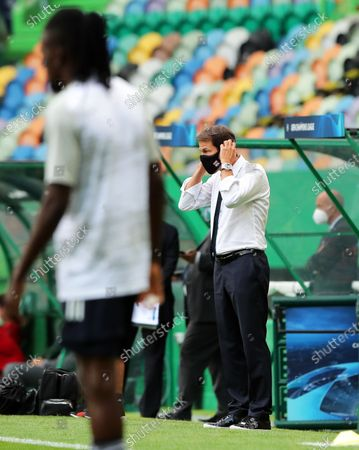 Olympique Lyon's head coach Rudi Garcia adjusts his protective face mask prior to the UEFA Champions League semi final soccer match between Olympique Lyon and Bayern Munich in Lisbon, Portugal, 19 August 2020.