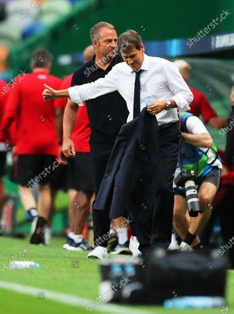 Bayern Munich's head coach Hansi Flick (L) greets Olympique Lyon's coach Rudi Garcia (R) prior to the UEFA Champions League semi final soccer match between Olympique Lyon and Bayern Munich in Lisbon, Portugal, 19 August 2020.