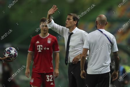 Lyon's head coach Rudi Garcia instructs his players during the Champions League semifinal soccer match between Lyon and Bayern Munich at the Jose Alvalade stadium in Lisbon, Portugal