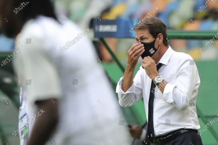 Lyon's head coach Rudi Garcia adjusts his face mask before the Champions League semifinal soccer match between Lyon and Bayern Munich at the Jose Alvalade stadium in Lisbon, Portugal