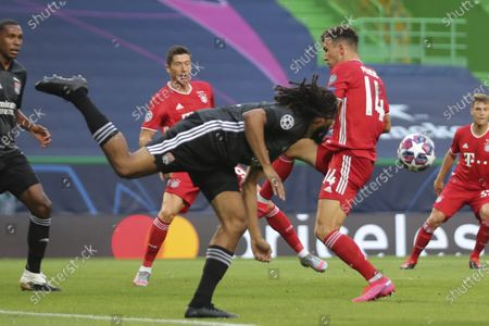 Lyon's Jason Denayer, left, heads the ball past Bayern's Ivan Perisic during the Champions League semifinal soccer match between Lyon and Bayern Munich at the Jose Alvalade stadium in Lisbon, Portugal