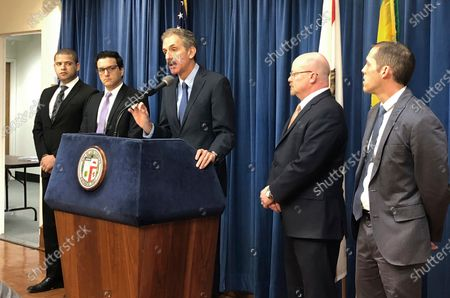 Los Angeles City Attorney Mike Feuer, at podium, speaks at a news conference in Los Angeles. The operator of The Weather Channel mobile app has agreed to change how it informs users about its location-tracking practices and sale of personal data as part of a settlement with the Los Angeles city attorney's office, officials said . Feuer alleged in a 2019 lawsuit in Los Angeles County Superior Court that app users were misled when they agreed to share their location information in exchange for personalized forecasts and alerts