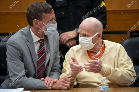 Stock Photo of Joseph James DeAngelo, right, speaks with public defender Joseph Cress at the end of the second day of victim impact statements at the Gordon D. Schaber Sacramento County Courthouse, in Sacramento, Calif. Victims of California serial killer and rapist, DeAngelo want him in a maximum security prison far, far away if he can't spend the rest of his life on death row. But they may not hold much sway over where or how the 74-year-old former police officer is imprisoned once he is sentenced on Friday, Aug. 21