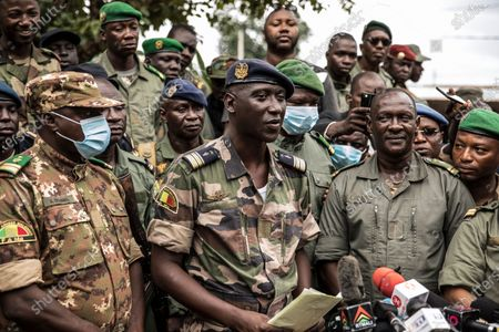 Colonel-Major Ismael Wague, center, spokesman for the soldiers identifying themselves as the National Committee for the Salvation of the People, holds a press conference at Camp Soudiata in Kati, Mali, a day after armed soldiers fired into the air outside President Ibrahim Boubacar Keita's home and took him into their custody. African and Western leaders condemned on Wednesday the junta that forced Mali's president from power, warning the coup was a deep setback for the West African nation that could threaten the battle against Islamic extremism