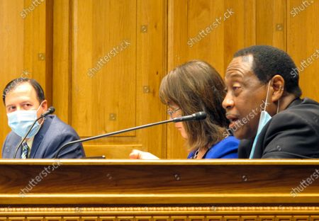 House Democratic leader Sam Jenkins, D-Shreveport, right, asks questions about Secretary of State Kyle Ardoin's proposed emergency plan for the fall Louisiana elections,, in Baton Rouge, La