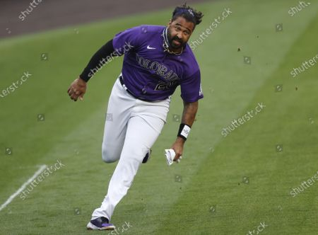 Colorado Rockies' Matt Kemp heads to home plate to score on a single hit by Raimel Tapia off Houston Astros starting pitcher Framber Valdez in the second inning of a baseball game, in Denver