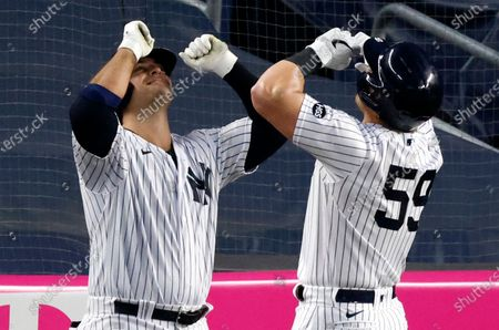 New York Yankees first baseman Luke Voit (R) celebrates his solo home run off of Tampa Bay Rays starting pitcher Tyler Glasnow (not pictured) with teammate New York Yankees first baseman Mike Ford (L) in the third inning of a MLB game at Yankee Stadium in the Bronx, New York, USA, 19 August 2020.
