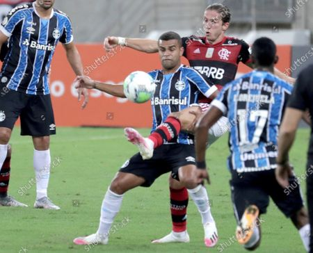Stock Photo of Filipe Luis (R) of Flamengo vies for the ball with Alisson (L) of Gremio during a Brasileiro championship 2020 match between Flamengo and Gremio at Maracana stadium in Rio de Janeiro, Brazil, 19 August 2020.
