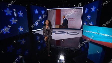 In this image from the Democratic National Convention video feed, former United States President Barack Obama finishes his remarks on the third night of the convention. At left is American actress Kerry Washington.