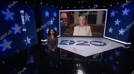In this image from the Democratic National Convention video feed, former United States Secretary of State Hillary Rodham Clinton, the 2016 Democratic Party nominee for President of the United States, and former US Senator from New York, makes remarks on the first night of the convention. Hosting is American actress Kerry Washington.