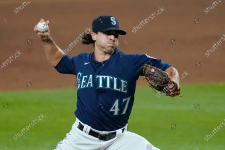 Seattle Mariners closing pitcher Taylor Williams throws to a Los Angeles Dodgers batter during the ninth inning of a baseball game, in Seattle. The Mariners won 6-4