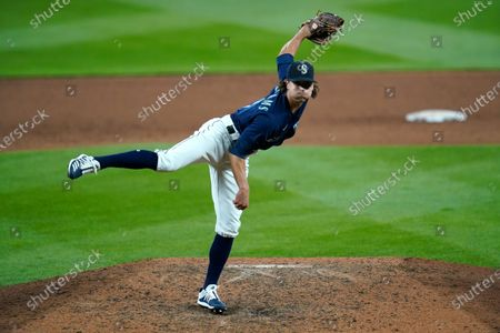 Seattle Mariners closing pitcher Taylor Williams throws against the Los Angeles Dodgers in a baseball game, in Seattle